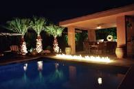 Adding fire features to a swimming pool can create an exciting fusion of elements to entertain your guests.