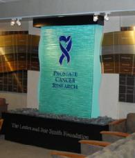 This shining blue water wall was crafted for the Baylor University's Urology department donor wall