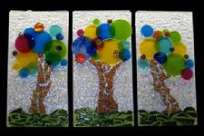 "A fun yet whimsical series of abstrat art glass pieces featuring ""Bubble trees"" in primary hues.  Originally crafted for a children's center."