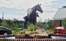 The finished cast bronze sculpture fountain for the wah kon tah ranch