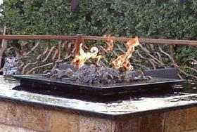 a close up of the fire and water pit at the Grotto Ristorante in Houston, Texas.