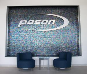 This water wall fountain was custom tailored to match the color scheme of Pason's office reception area
