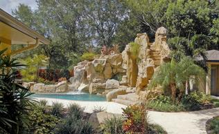 Artificial rock can be used in a lot of differentways. For instance, to make a giant grotto and slide for your swimming pool!
