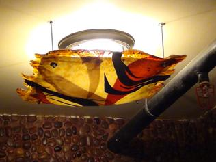 Theme Designs' glass studio specializes in custom art glass light fixtures of all shapes and sizes, such as this large plate cover for El Toro.